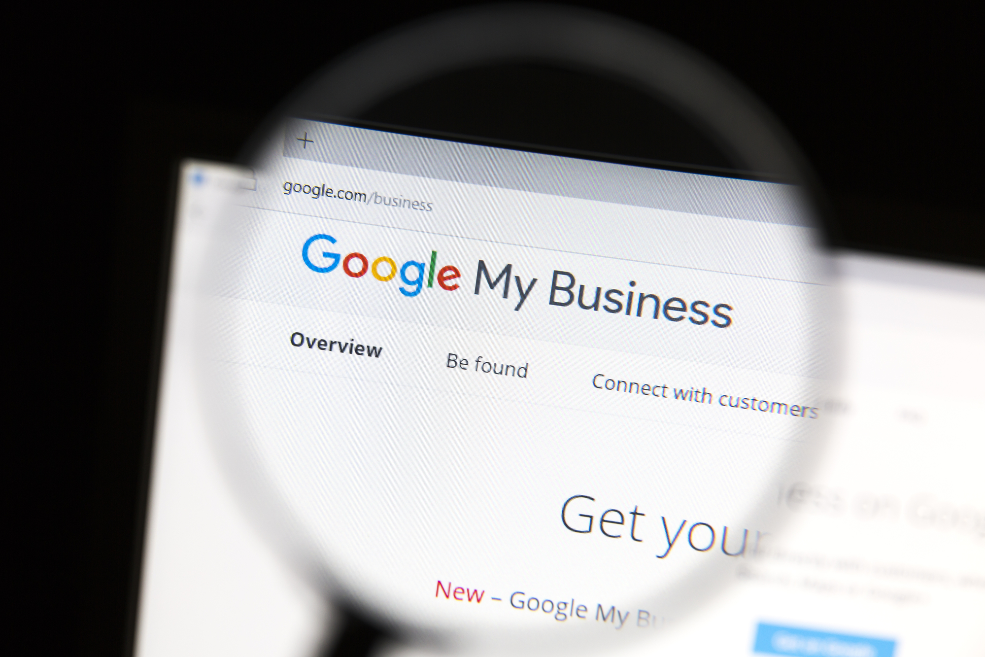Closeup of wordpress website under a magnifying glass. Google My Business connects you directly with customers, whether they're looking for you on Search, Maps